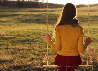 alone woman sitting on swing, solitude