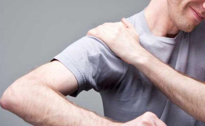 frozen shoulder, man with pain in shoulder