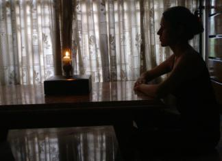 woman doing Trataka with a candle