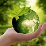 Sustainable living concept of a green Earth in a hand