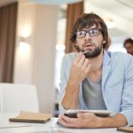 Man think on his desk | 7 tools to become mentally flexible