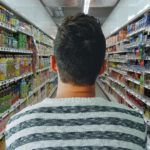 man in grocery aisle, sugar-free products