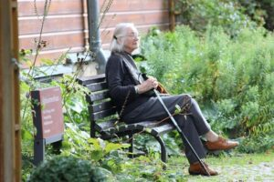 Senior Citizens sitting on a park bench alone