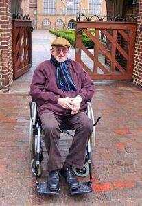 Senior man sitting on a wheelchair
