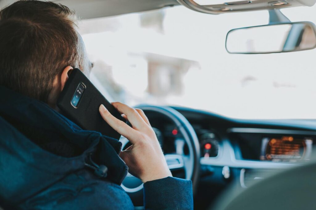 Man talking on cell phone while driving
