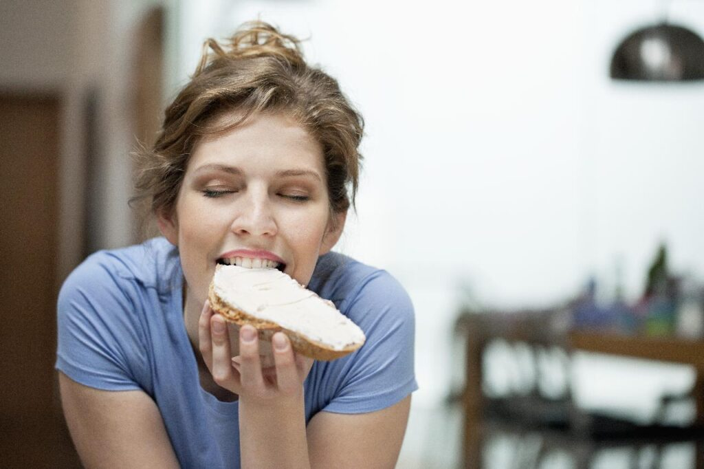 101 lame excuses: woman eating with pleasure