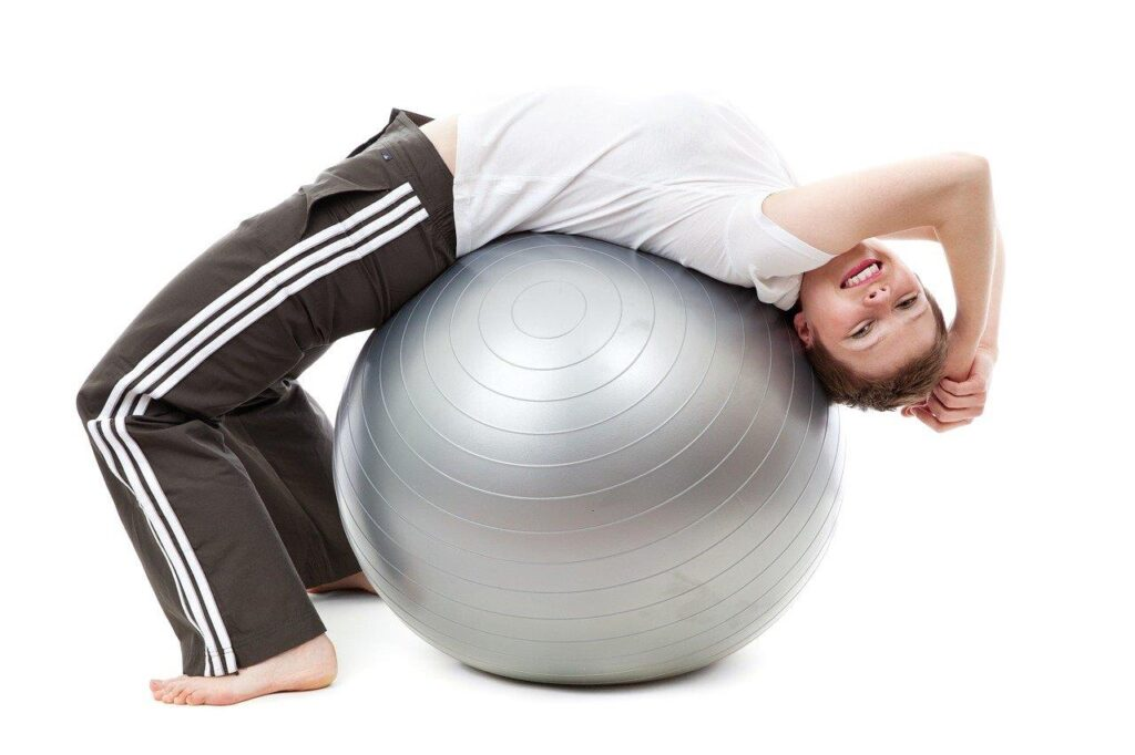 101 excuses: happy woman exercising with a gym ball