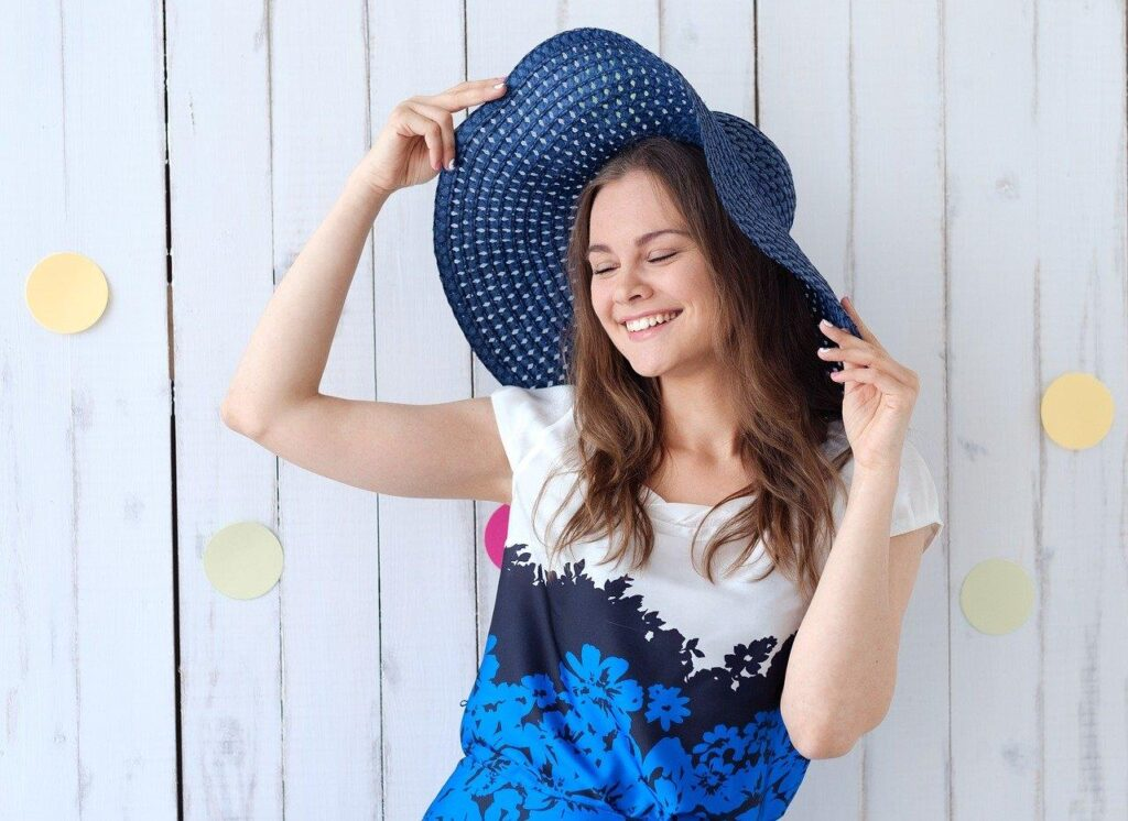 Beautiful and happy young woman wearing a hat